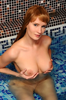 Busty Anna Is Nude By The Pool