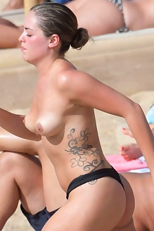 Olympia Valance Topless On The Beach